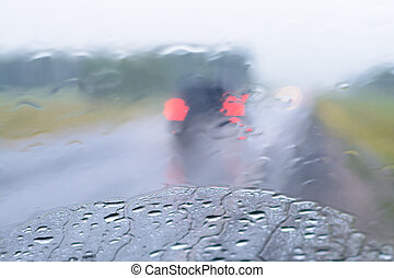 Rain in the automotive glass in the summer