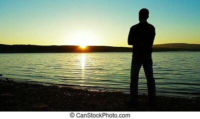 The Lonely Man Longs And Looks At A Sunset. - The person...