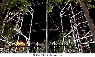 Roller coaster - The roller coaster ride on a dark...