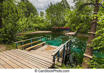 Beautiful views of the blue lake with wooden bridge.