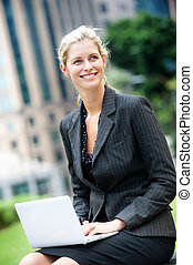 Businesswoman with Laptop - A young and attractive...