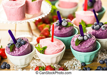 Popsicles - Homemade blueberry and strawberry popsicles made...