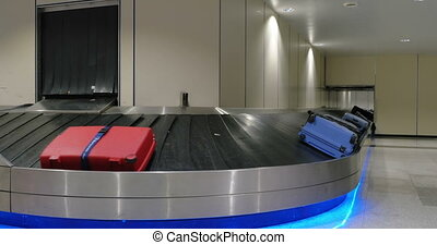 Baggage claim area at the airport - Suitcases on moving...