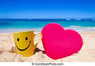 Happy face mug with heart shape on the beach - Happy face...