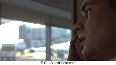 Man having phone conversation at airport