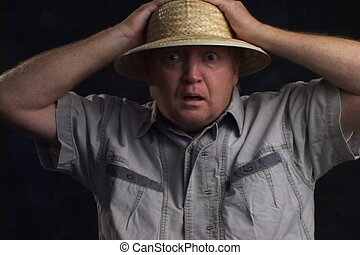 Silly Man In Safari Hat - Mature man in a straw safari hat...