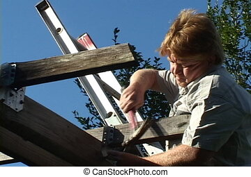 Amateur Home Repair - Red haired man standing on ladder...
