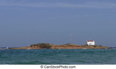 Greek flag and church remote island - Greek flag and chapel...