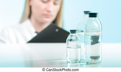 Lab worker counting chemicals - Counting lives Lab worker...