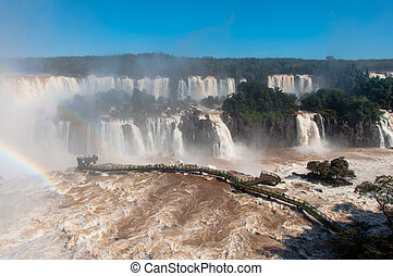 Rainbow over gorgeous waterfalls of Iguazu, Brazil.