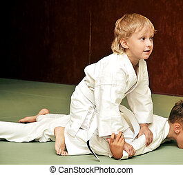 competition - aikido boys are fighting for the competition
