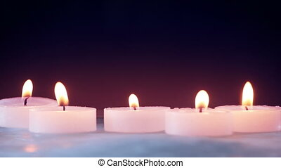 burning candles on ice seamless loop