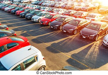 Dealer New Cars Stock. Colorful Brand New Compact Vehicles...