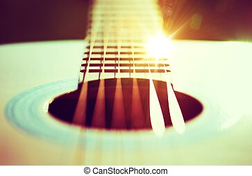 Guitar Strings Concept Photo Guitar Playing Theme with Sun...