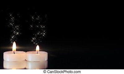 two candles burning seamless loop