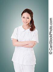 Attractive Asian nurse, closeup woman portrait.