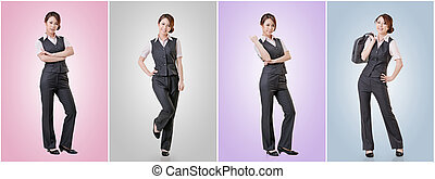 Asian business woman standing against studio background,...
