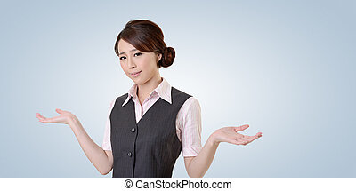 Helpless young business woman shrugs her shoulders closeup...