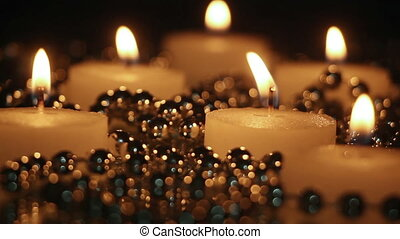 burning candles and beads in night seamless loop