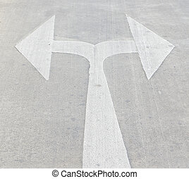 Turn left and right traffic sign painted on concrete road