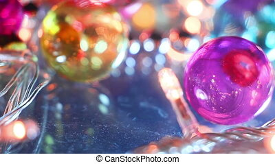 blinking lightbulbs and christmas balls close-up