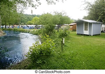 Camping forest meadow in the river shore - Camping forest...