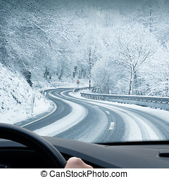 Winter Driving - Curvy road leading through a mountain...