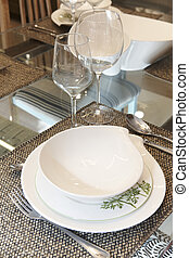 Crockery set over a table ready to be served Vertical