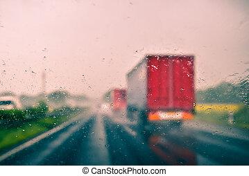 Bad weather driving on a highway