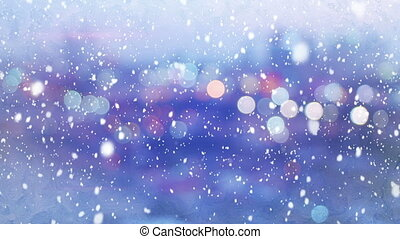 defocused lights evening wintry city and snowfall loop -...