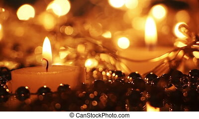 close-up burning candle and christmas lights seamless loop