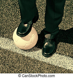 Businessman with a Soccer Ball - Businessman with soccer...