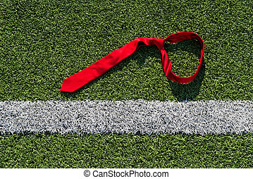 Tie on a Soccer Field - Red tie on a soccer field