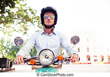 Man in helmet riding on scooter - Handsome man in helmet...