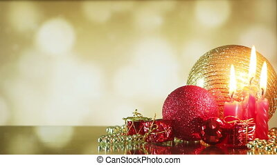 christmas balls and candle on shiny background seamless loop