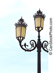 Antique lamp post with a sky background