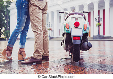 Cropped image of a couple having date in town. Standing near...