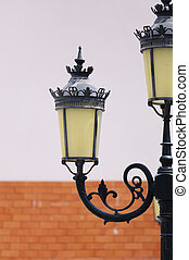 Antique lamp post with a wall background
