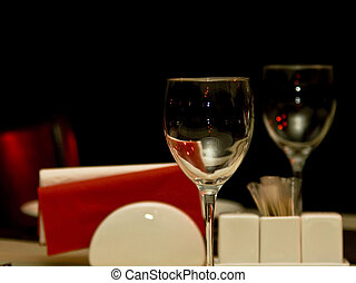 Restaurant - wineglasses and table appointments in the dark...