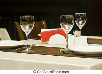 In the restaurant - wineglasses and table appointments -...