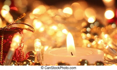 candle and christmas lights close-up out of focus