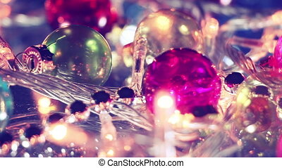 blinking lightbulbs and christmas balls close-up panning