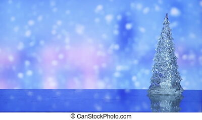 christmas tree and snowfall on background seamless loop