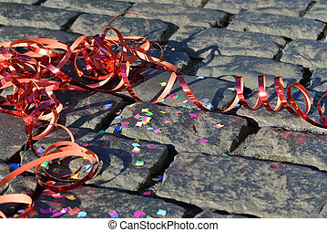 Party Time - Confetti and streamers on the ground - symbol...