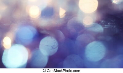 christmas light bokeh reflected in glass panning