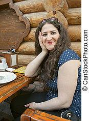 brunette gir - curly brunette girl in summer cafe