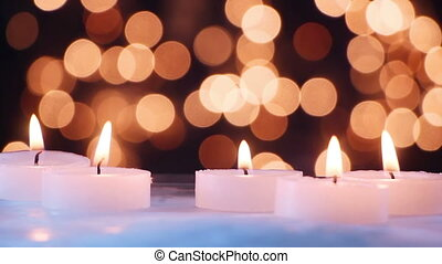 burning candles and bokeh light seamless loop