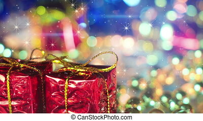 christmas gift boxes and shimmering particles loopable