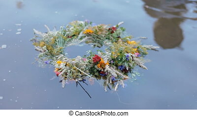 A motley grass wreath on the water
