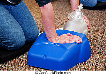 CPR Training - This photo shows a woman taking a CPR class...